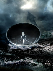 Compass in the sea on dark sky background