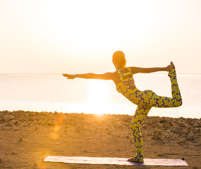 Yoga practice at sunrise