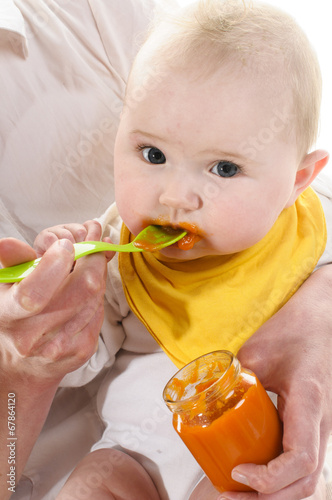 canvas print picture Baby bekommt Brei