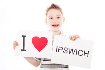 Boy with Ipswich city sign