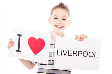 Boy with Liverpool city sign