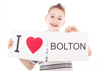 Boy with Bolton city sign