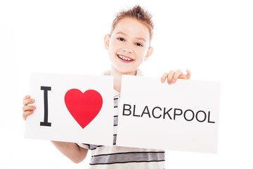 Boy with Blackpool city sign