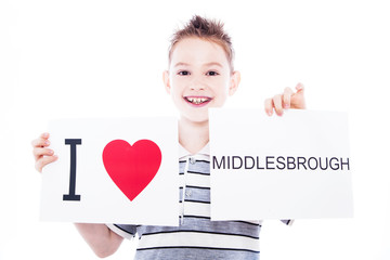 Boy with Middlesbrough city sign