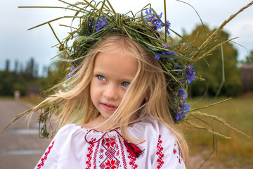 Portrait of ukrainian girl in chaplet