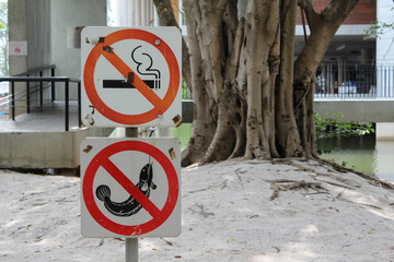 No smoking and no fishing sign in the park.