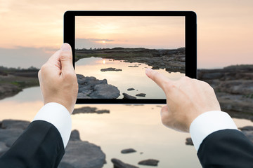 Businessman hands tablet taking pictures Sam Phan Bok rock canyo