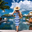 Woman sailor striped in dress near poolside