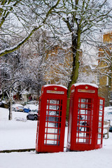 Traditional UK Phone Box in Snow