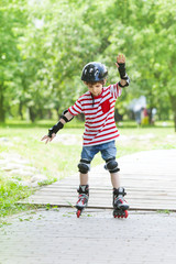boy trains rollerblading in the Park