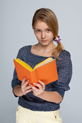 Clever young girl with a book