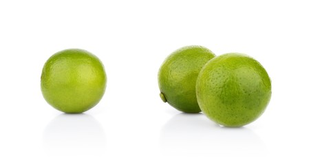 Three whole limes isolated on a white background