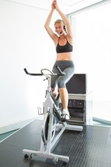 Spin class led by motivational instructor