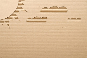 Sun and clouds cut out on cardboard