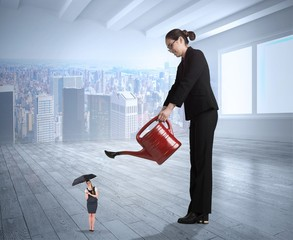 Composite image of businesswoman watering tiny businesswoman