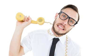 Geeky businessman being strangled by phone cord