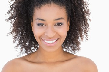 Pretty girl with afro hairstyle smiling at camera