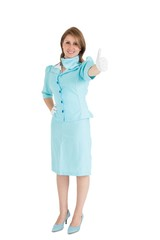 Stewardess in blue uniform gesturing thumbs up