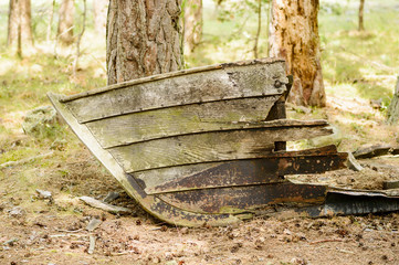 Old rotting boat on land