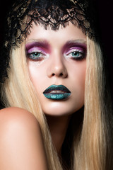 Fashion portrait of young woman with stage make-up