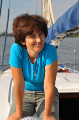 Smiling woman on old yacht