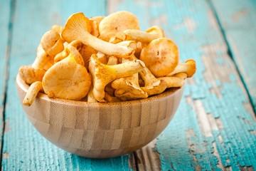fresh chanterelle mushrooms on a wooden background