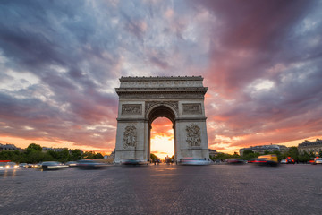 Arc de Triomphe and traffic along the Champs-Elysees at sunset w