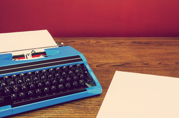 blue typewriter and paper