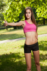 Young brunette fitness girl.