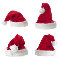 Vier Nikolausmützen auf weissem Untergrund