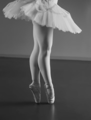Graceful ballerina standing en pointe