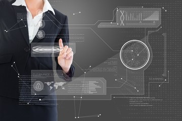 Composite image of businesswoman pointing  to interface