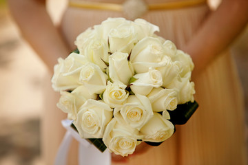 Bride holding wedding flower bouquet