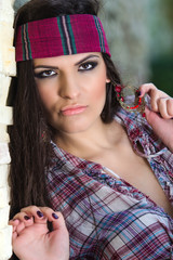 Beautiful young brunette woman with a headband in her hair