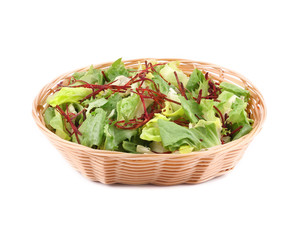 Lettuce leaves and beet in basket.