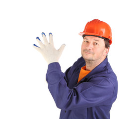 Worker putting on rubber glove.