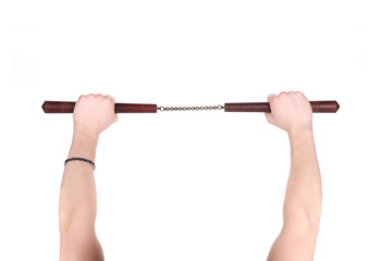 Hands hold martial arts nunchaku.