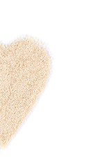 Half of heart shape from sesame seeds.
