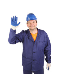 Worker showing five in rubber glove.