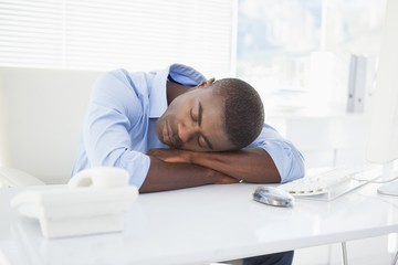 Tired businessman sleeping at his desk