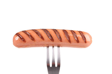 Grilled sausage on a fork.