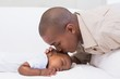 canvas print picture - Adorable baby boy sleeping while being watched by father