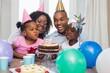 Leinwanddruck Bild - Happy family celebrating a birthday together at table