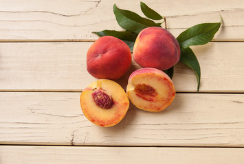 Fresh organic peaches sliced with pit - top view