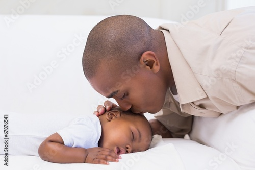 canvas print picture Adorable baby boy sleeping while being watched by father