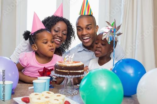 Leinwanddruck Bild Happy family celebrating a birthday together at table