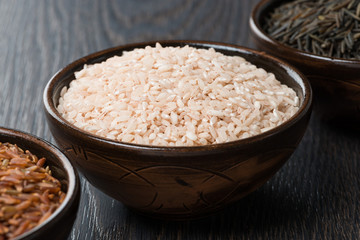 pink rice in ceramic bowl