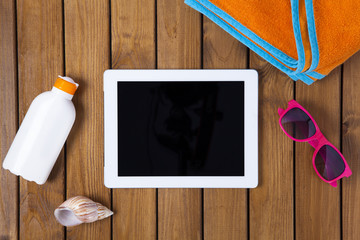 Tablet pc on the deck with summer concept