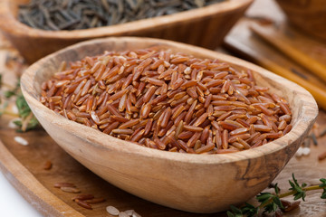 red rice in a wooden bowl, close-up