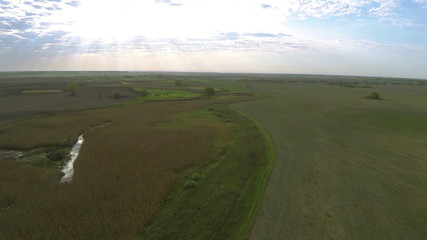 Rural Panorama  with sky beams  .Aerial   landscape
